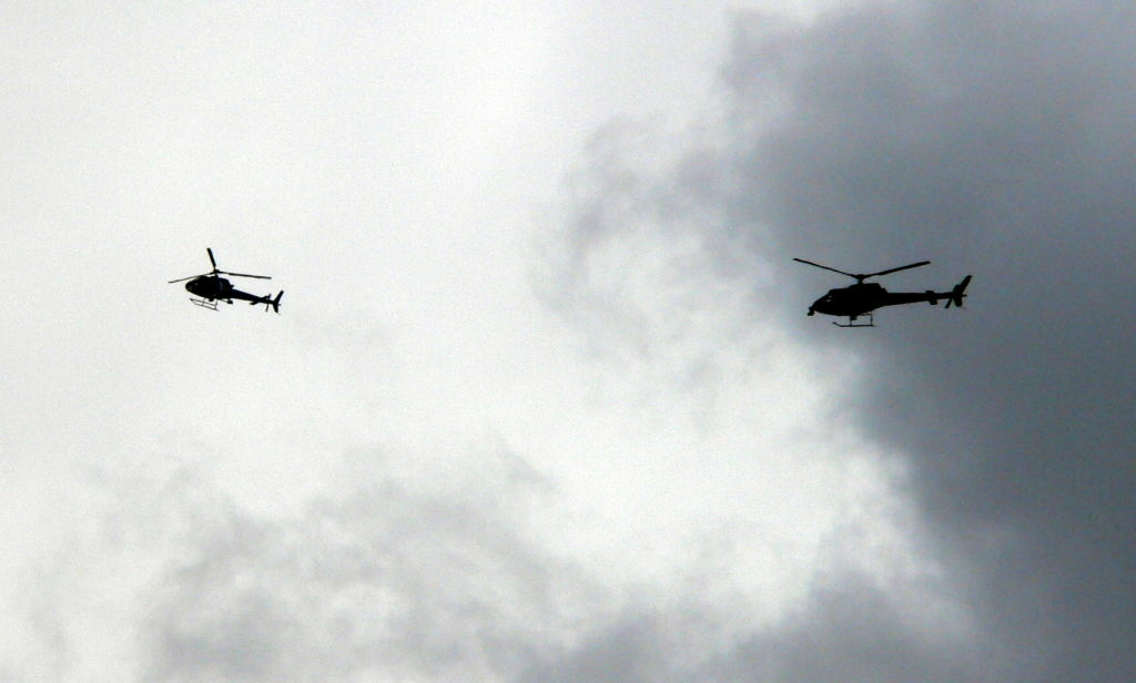 News helicopters fly above the scene of police activity in Glendale, Calif. A first-of-its-kind pool agreement among Southland news organizations guarantees that similar craft won't crowd the skies over Carmageddon II this weekend along the 405 Freeway.