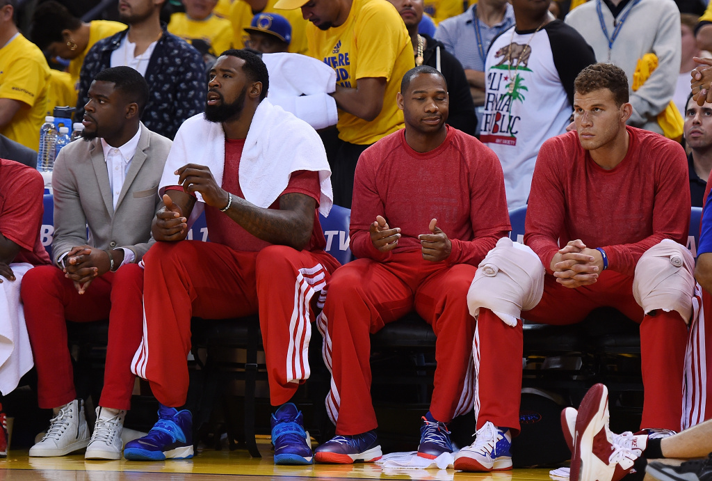 Los Angeles Clippers players sit on the bench wearing their warm-up tops inside out against the Golden State Warriors in Game Four of the Western Conference Quarterfinals during the 2014 NBA Playoffs at ORACLE Arena on April 27, 2014 in Oakland, Calif.