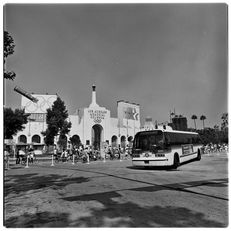 A Southern California Rapid Transit District bus in front of the Coliseum during the 1984 Olympics.