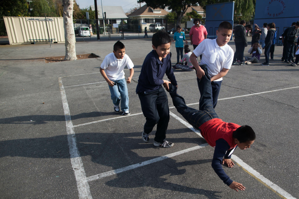 Students participate in a wheelbarrow race at Hooper Avenue Elementary School in Central Alameda, south of Downtown Los Angeles.