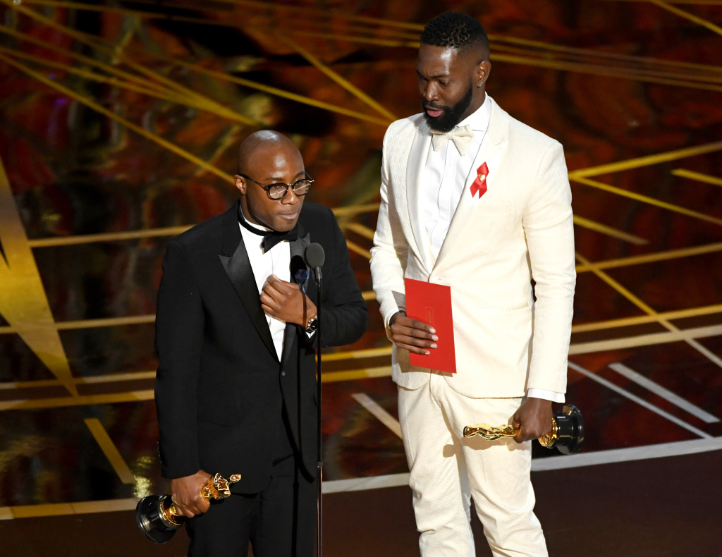 Writer/director Barry Jenkins (left) and writer Tarell Alvin McCraney accept Best Adapted Screenplay for 'Moonlight' onstage during the 89th Annual Academy Awards on February 26, 2017 in Hollywood, California.