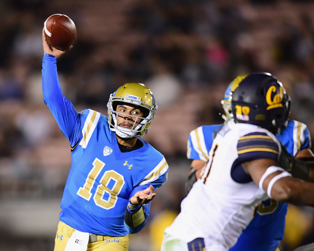 Devon Modster (#18) of the UCLA Bruins passes during the third quarter of a game against the California Golden Bears on November 24, 2017 in Pasadena, California.