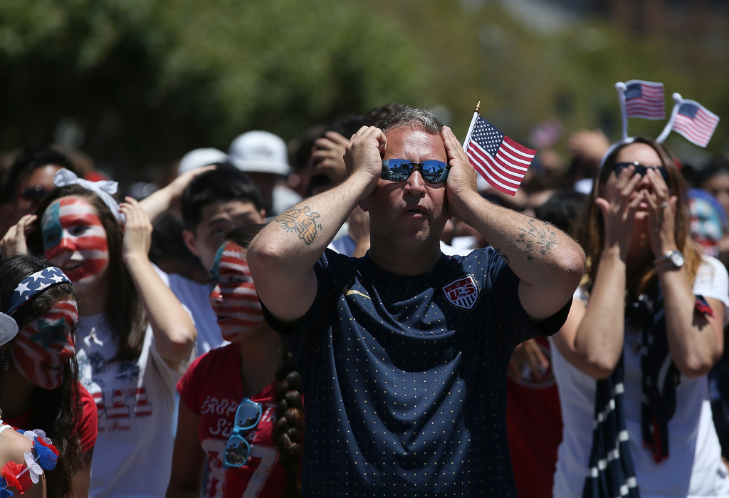 Soccer fans react while watching a live simulcast of the FIFA World Cup quarter final match between USA and Belgium in San Francisco.