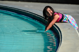 Penelope Rosendo, 3, splashes water in the fountain named after William Mullholand at Griffith Park on September 27, 2010 in Los Angeles, California.