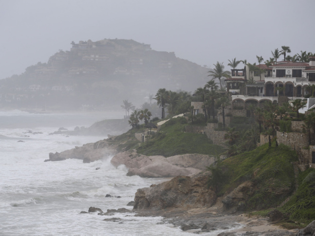 Waves hit the coast of Los Cabos, Mexico, on Sunday as Hurricane Odile neared landfall in the largely tourist area of the Baja California peninsula.