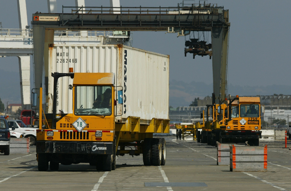 A truck drives off with a shipping container at the Port of Oakland July 1, 2004 in Oakland, California.