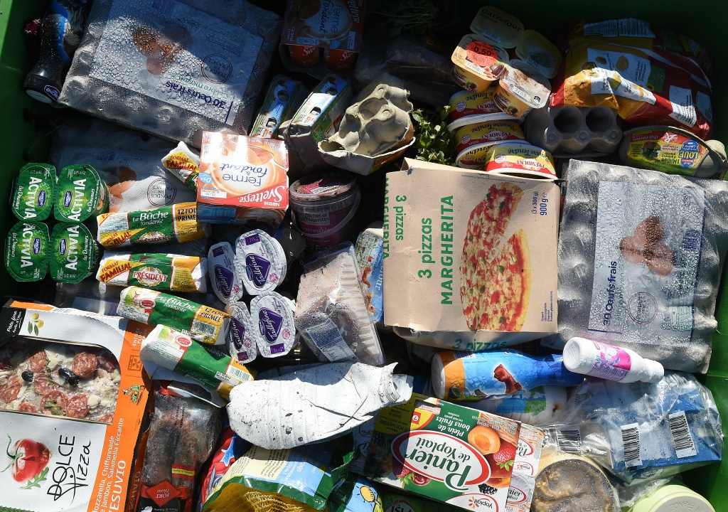 A picture taken on November 5, 2015 shows food waste in a plastic container before been crushed and transformed in a cooperative recycling site in Belesta-en-Lauragais.