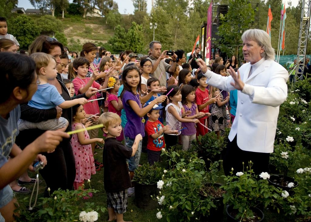Children learn how to conduct at the Pacific Symphony show, part of Newport Beach city's 'Concerts on the Green' series.
