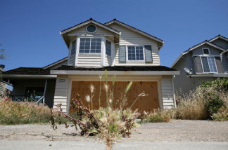 Weeds grow in the driveway of a foreclosed home on May 7, 2009 in Antioch, California.