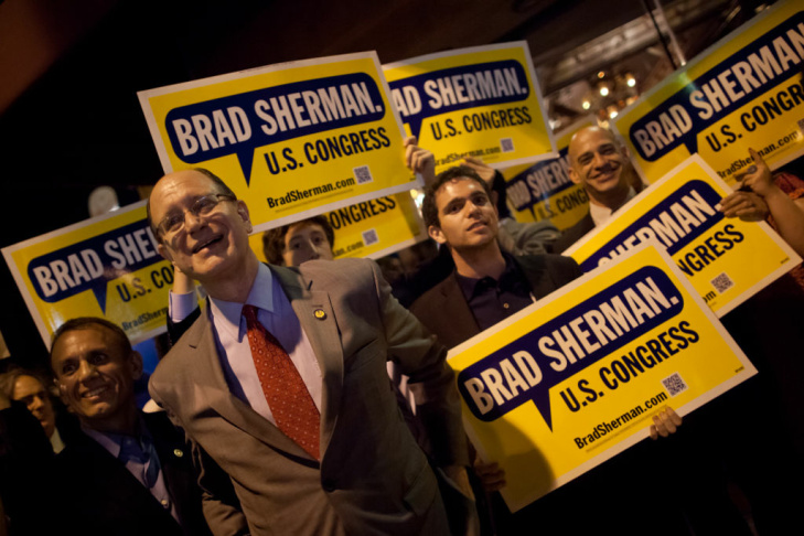 Cong. Brad Sherman celebrates with supporters outside his election night party in Encino.