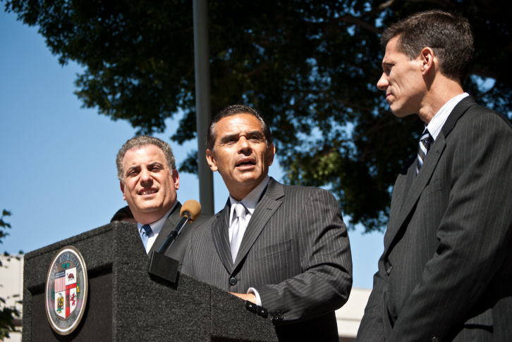 Los Angeles Mayor Antonio Villaraigosa, left, and Meg Whitman, right, help third grade elementary math class students: David Ozorio, middle, and Cecil Pascal, right, at the 99th St. Elementary campus Wednesday, Sept. 14, 2011, in Los Angeles.