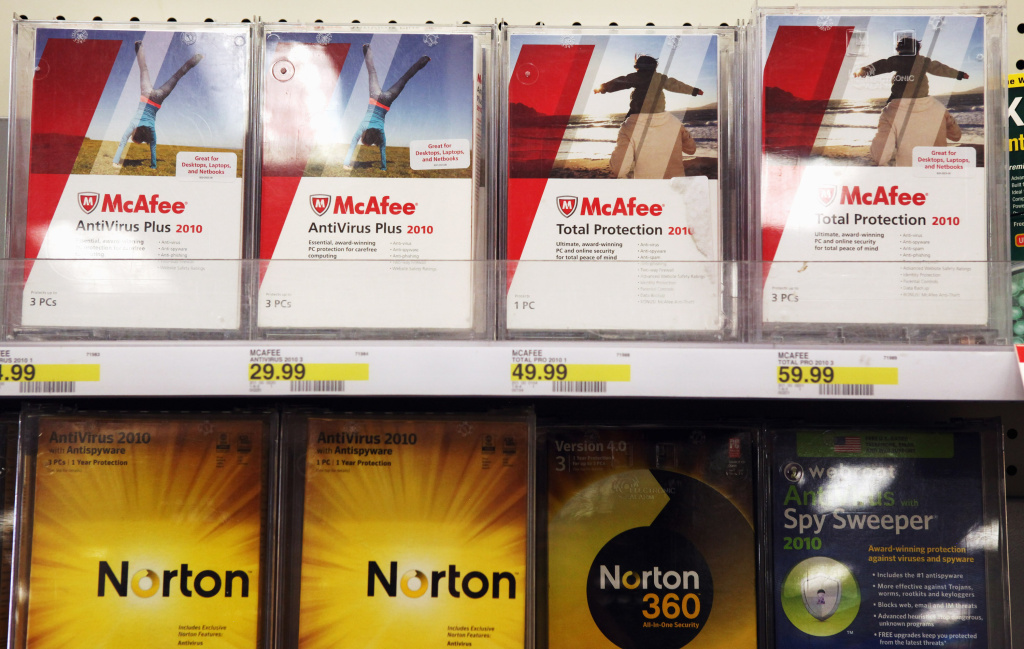 Boxes of McAfee security software are displayed alongside Norton Anti-virus software by Symantec on a shelf at a Target store August 19, 2010 in Colma, California. Intel announced today that it plans to buy security software maker McAfee for a reported $7.68 billion.