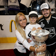 Slava Voynov #26 of the Los Angeles Kings and family celebrate after the Kings win the Stanley Cup after defeating the Rangers 3-2 in double overtime during Game Five of the 2014 Stanley Cup Final at Staples Center on June 13, 2014 in Los Angeles, California.