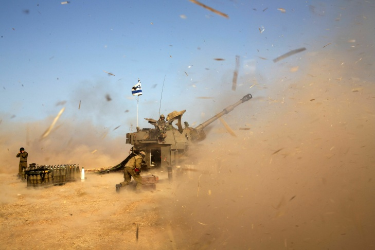 An Israeli artillery fires a 155mm shell towards targets in the Gaza Strip from their position near Israel's border with the Strip on July 12, 2014. Israel pounded Gaza for a fifth day today, vowing no let-up in its air campaign to halt rocket attacks by militants which has killed more than 120 Palestinians.