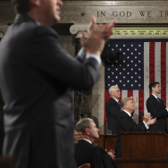 President Donald J. Trump and the entire chamber applaud toward Carryn Owens, widow of Navy Seal Ryan Owens, on Capitol Hill in Washington, Tuesday, Feb. 28, 2017, during his address to a joint session of Congress. (Jim Lo Scalzo/Pool Image via AP)