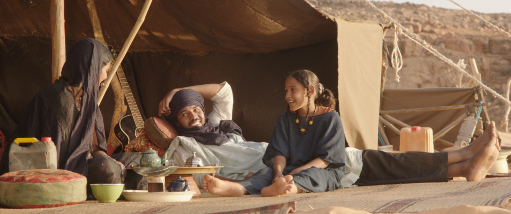 In the movie, the cattle herder Kidane (center, played by Ibrahim Ahmed) and his family live in a tent in the mountains near Timbuktu.