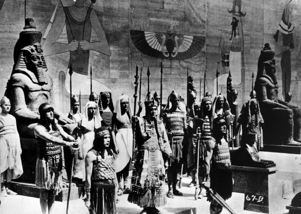 A scene from silent version of the 1923 epic film 'The Ten Commandments', directed by Cecil B DeMille, one of D.W. Griffith's contemporaries in the early film industry. The Egyptian Pharaoh is surrounded by his guards as he prepares to lead his army forth.