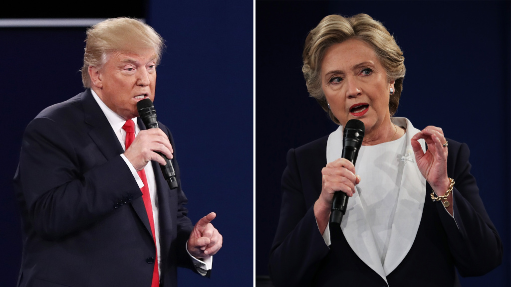In this composite image, Republican presidential nominee Donald Trump (L) and Democratic presidential nominee Hillary Clinton respond to questions during the town hall debate at Washington University on Sunday, Oct. 9, 2016 in St. Louis, Missouri.
