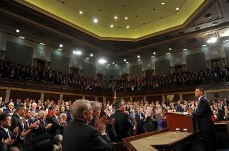 Members of Congress and the administration stand inside the House of Representatives as President Barack Obama addresses them during his State of the Union speech in 2010.