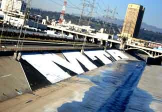 Graffiti marks the concrete walls of the Los Angeles river near downtown L.A.