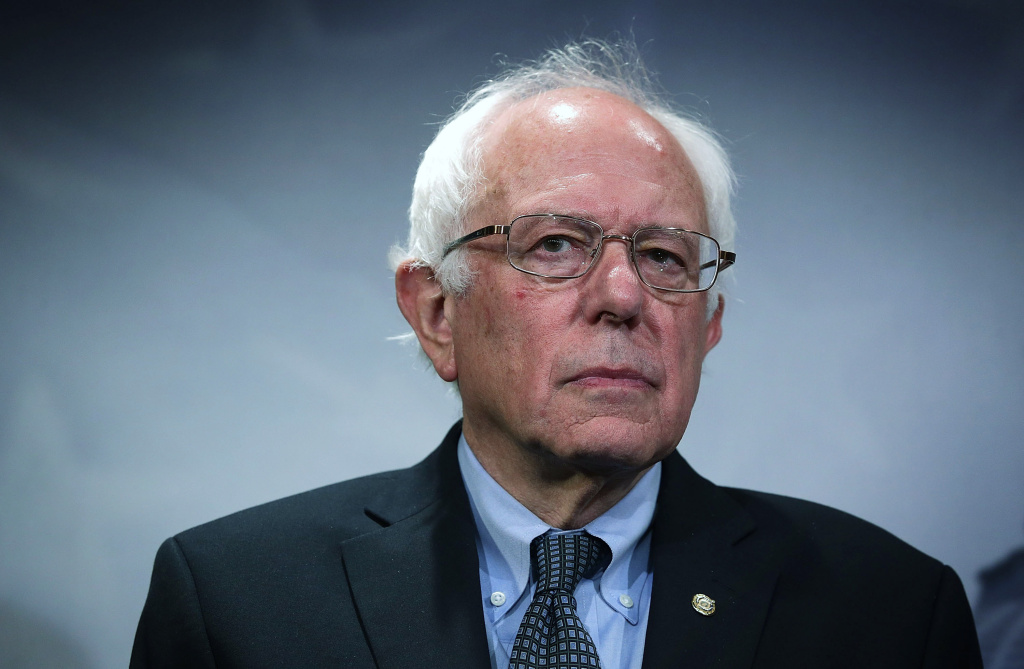 WASHINGTON, DC - SEPTEMBER 17:  U.S. Sen. Bernie Sanders (I-VT) listens during a news conference about private prisons September 17, 2015 on Capitol Hill in Washington, DC. Sanders was joined by Rep. Keith Ellison (D-MN) to announce that they will introduce bills to ban private prisons.  (Photo by Alex Wong/Getty Images)