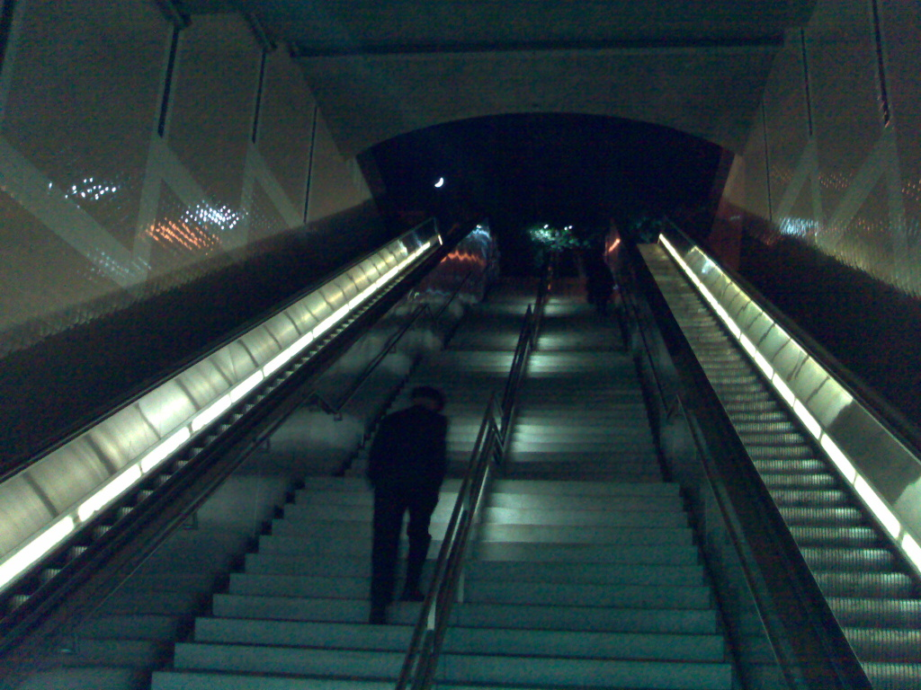 An LA Metro train station at night.