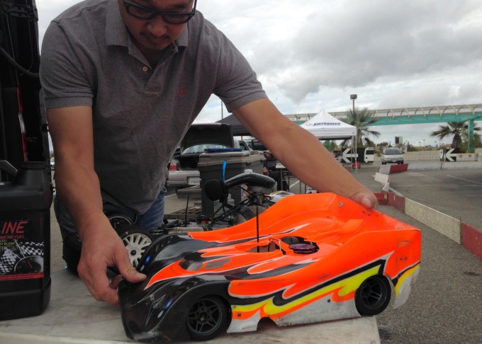 Greg Shum shows off his eight scale remote control car.