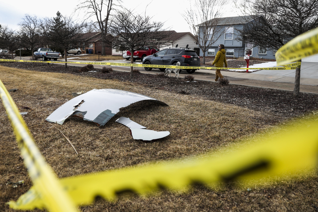 Pieces of an airplane engine from Flight 328 sit scattered in a neighborhood on February 20, 2021 in Broomfield, Colorado.