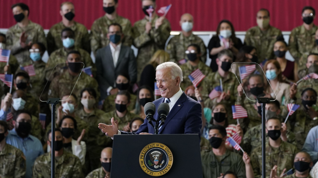 President Biden addresses U.S. service members Wednesday at Royal Air Force Mildenhall in Suffolk, England, on the first stop of his first overseas trip as president.
