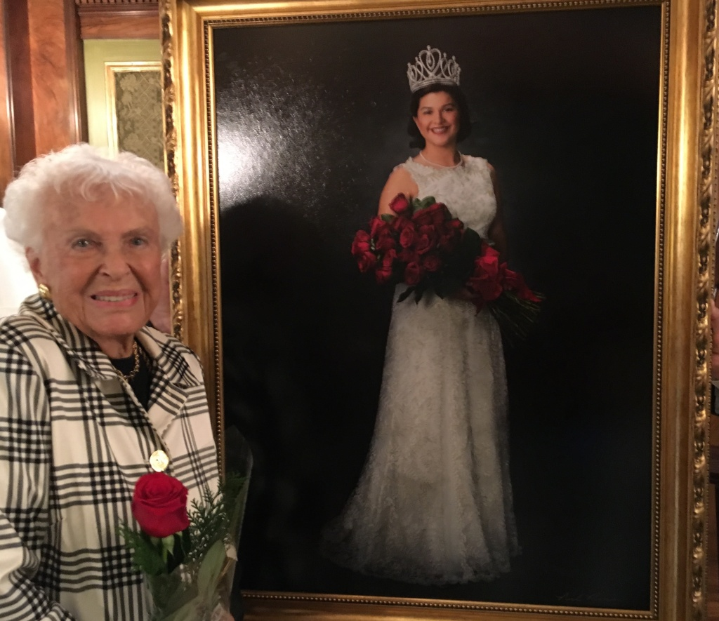 Margaret Huntley Main, the 1940 Rose Queen, stands at Tournament House in Pasadena alongside a just-unveiled portrait of 2018 Rose Queen, Isabella Marez of Altadena. Marez is the 100th woman to hold the Rose Queen title since 1905.