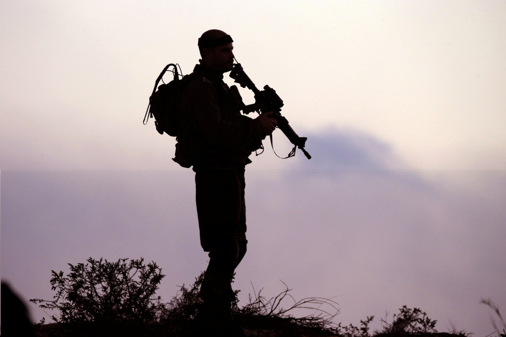 An Israeli soldier keeps his position near Israel's border with the Gaza Strip on July 29, 2014. The Israeli offensive, which began on July 8 to end Hamas rocket attacks on the Jewish state, has killed more than 1,100 Palestinians, mostly civilians according to the United Nations, while 56 lives have been lost on the Israeli side, all but three of them soldiers .