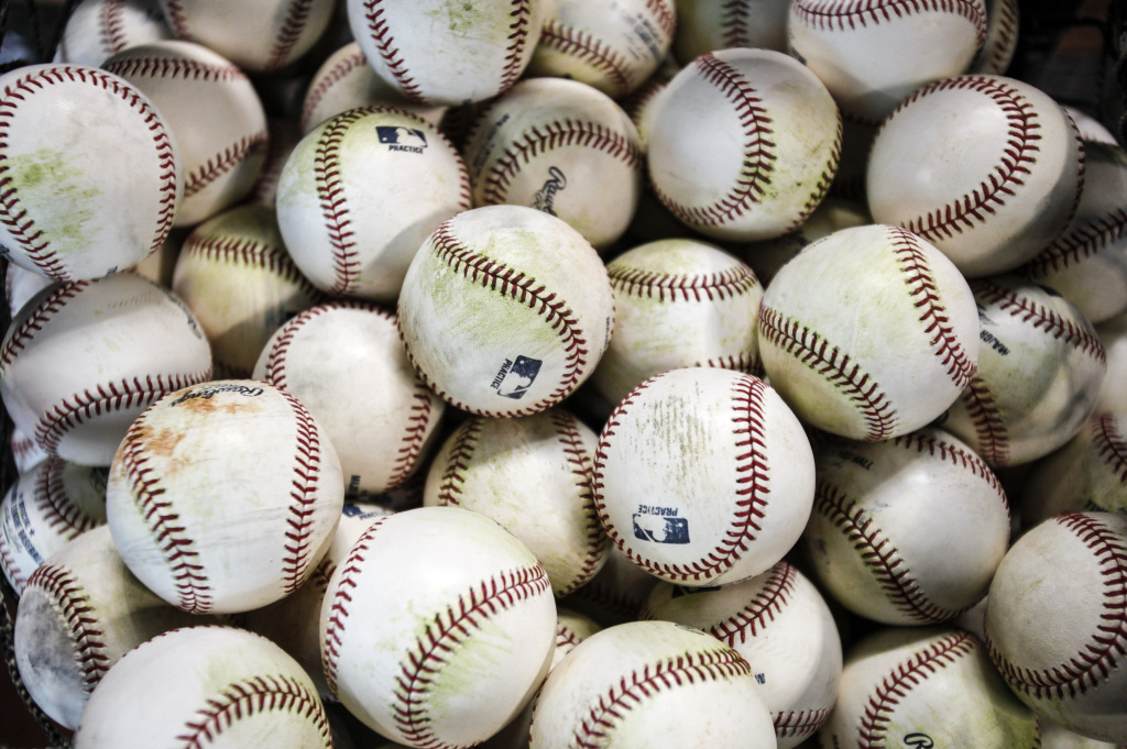 A bucket of baseballs for batting practice is seen before the Texas Rangers play the Houston Astros on Opening Day at Minute Maid Park on March 31, 2013 in Houston, Texas.