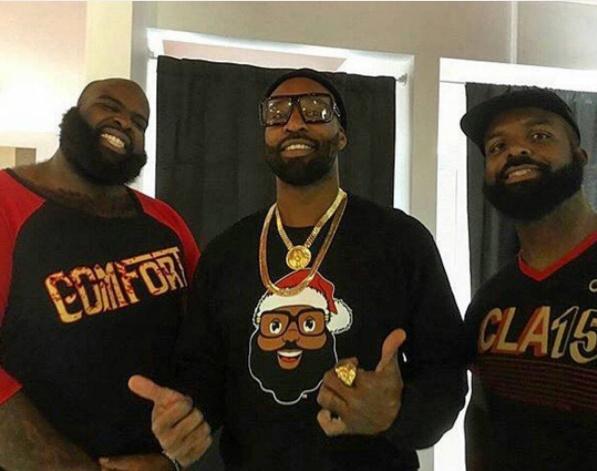 Baron Davis (center) wears a sweater featuring Black Santa, offered on his new site BlackSanta.com