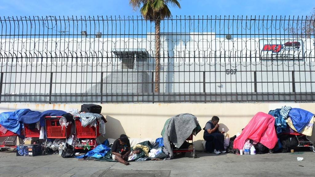 Homeless women sit amid their belongings in downtown Los Angeles on Jan. 1, 2014.