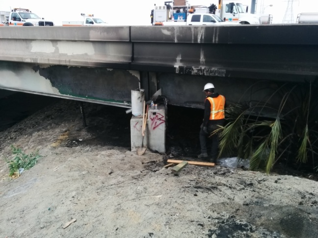 Damage on the Rio Hondo bridge after a fire.