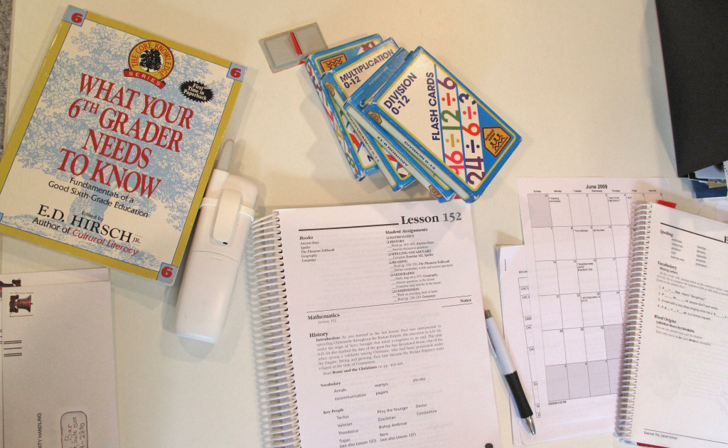 File: Teaching aids, exercise books, bills and a daily schedule rest on the desk of a homeschooling mother in the family's home in Columbia, Maryland on June 17, 2009.