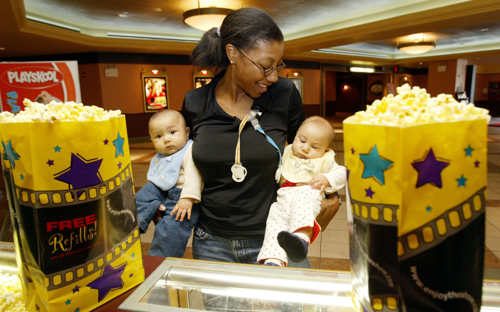 Mother Wanda Cole-Frieman and her twins Taylor and Isaac attend a screening of 'Cold Mountain' at Leows Movie Theater on 34th Street January 6, 2003 in New York City.