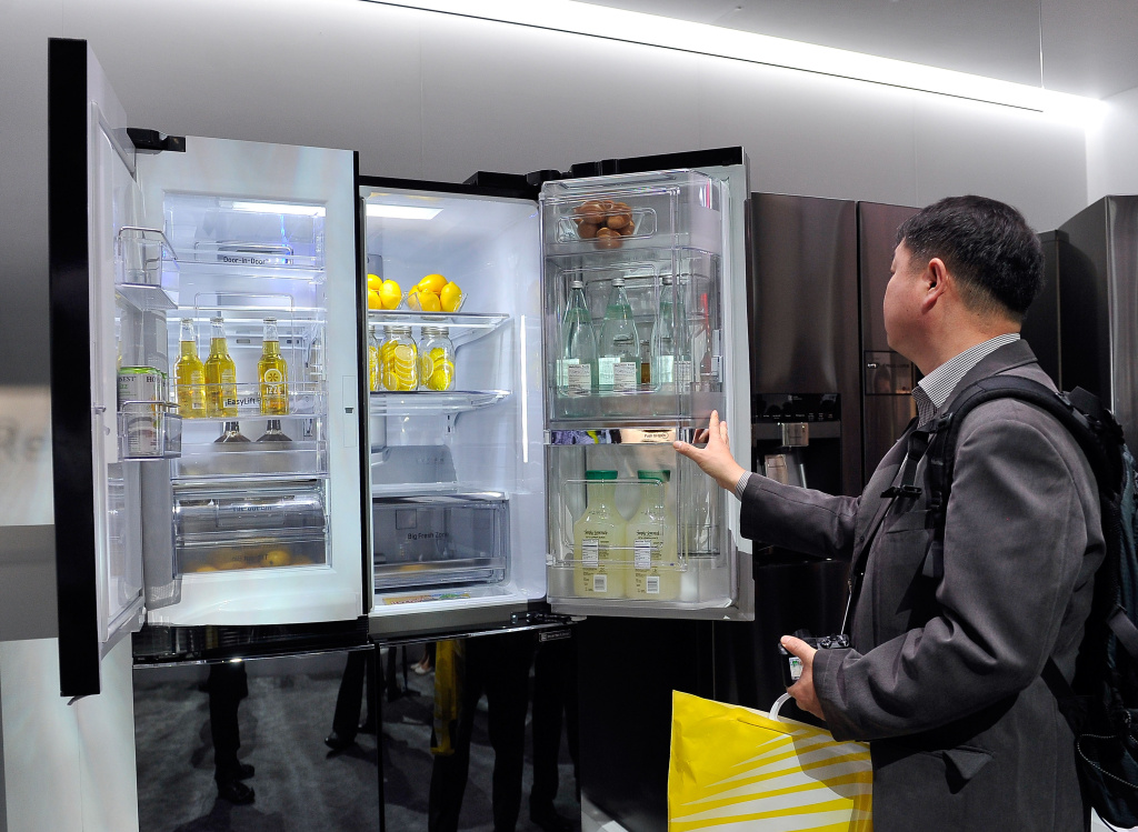LAS VEGAS, NV - JANUARY 06:  An attendee looks over the LG Double Door-in-Door refrigerator at the 2015 International CES at the Las Vegas Convention Center on January 6, 2015 in Las Vegas, Nevada. CES, the world's largest annual consumer technology trade show, runs through January 9 and is expected to feature 3,600 exhibitors showing off their latest products and services to about 150,000 attendees.