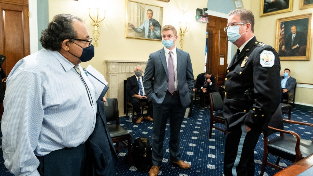 Rep. Raul Grijalva, D-Ariz., left, speaks before the start of a House Natural Resources Committee in June. Grijalva recently tested positive for the coronavirus.