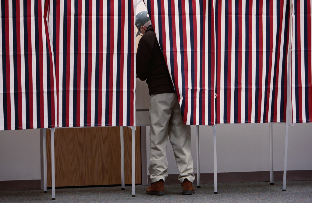 A man marks his ballot in a voting booth January 8, 2008 in Manchester, New Hampshire.