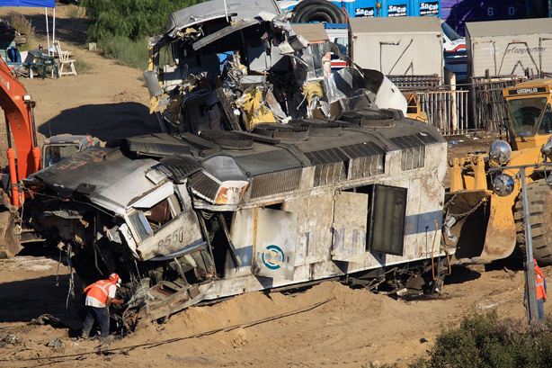 Workers remove the remains of a Metrolink commuter train on September 14, 2008 in Chatsworth, California. The Metrolink commuter train was involved in a head-on collision with a freight train on September 12. 24 people were killed in the crash and a 25th has died in a hospital. 95 were critically or seriously injured. Metrolink is putting the blame on a Metrolink engineer who was killed in the crash for not stopping for a red light so the freight train could pass on a parallel track. It is the worst rail disaster in Metrolink history and worst in the US in 15 years.