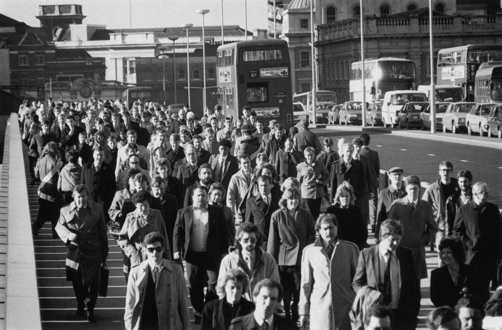 City workers crossing London Bridge during rush-hour, 1987.