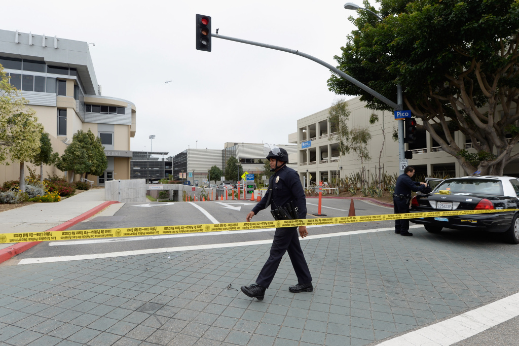 Los Angeles Police Department Officers block the entrance to Santa Monica College after multiple shootings were reported on June 7, 2013 in Santa Monica, California. According to reports, at least one person has died, four people hospitalized, and a suspect was taken into custody.