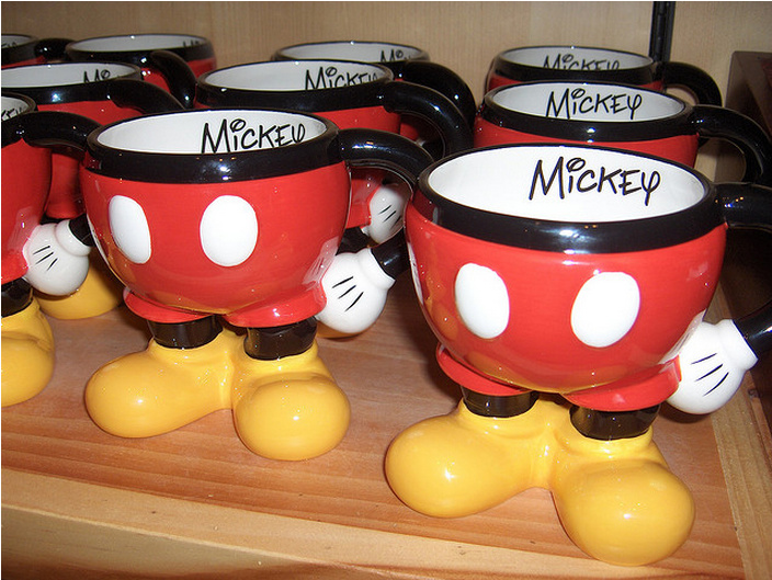 Mickey mugs | Starbucks announced on Monday a partnership with Disney to bring coffee shops into all six California and Florida theme parks.