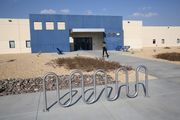 FILE: A family member walks into the Adelanto Detention Facility on Nov. 15, 2013 in Adelanto, California.