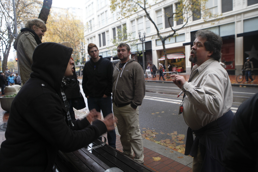 A demonstrator argues with a passer-by by on the street  in downtown Portland, November 2011. Recent studies suggest that when it comes to using statistical facts to change each other's minds, we're programmed to fail.