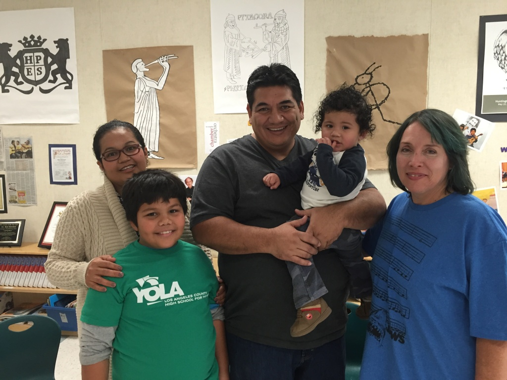 Luis Bonilla, left, with his parents, little brother, and music teacher René Rowland.
