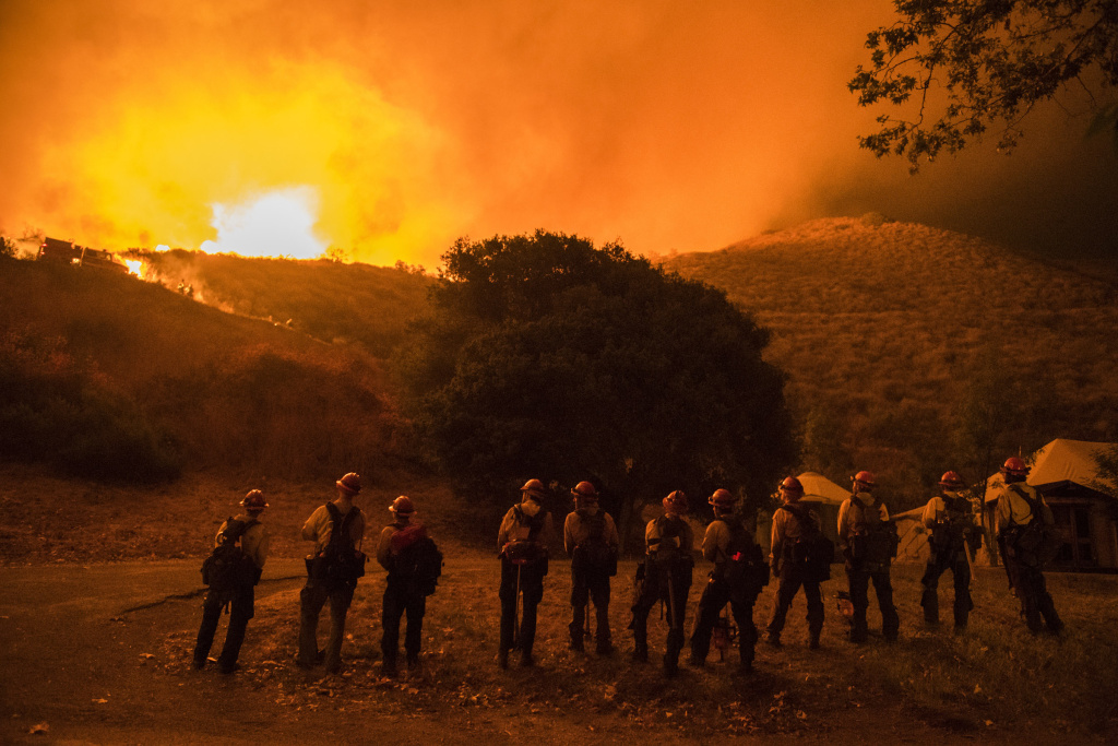 The King River Hotshots monitor a firing operation as their colleagues on the ridge above conduct the operation, meant to deprive the Sherpa Fire of fuels in El Capitan Canyon.