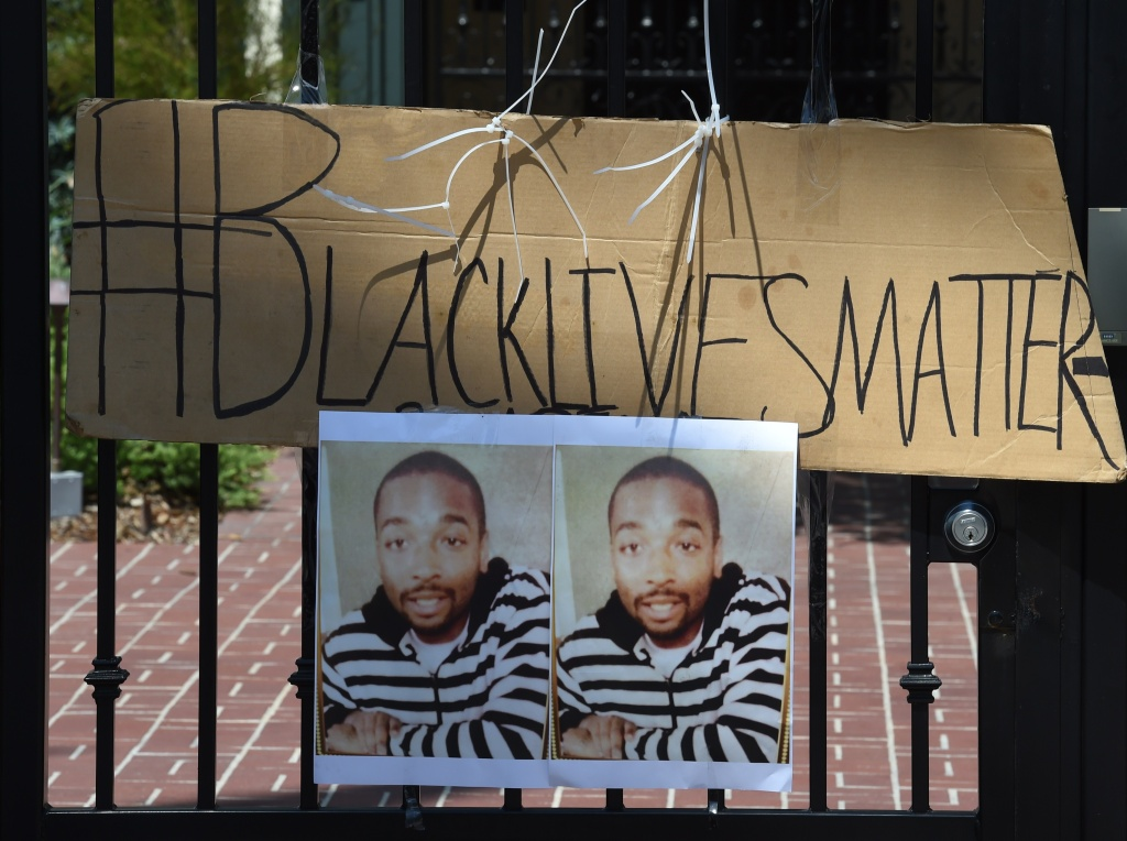 A protest sign showing and image of Ezell Ford as members of the 'Black Lives Matter' alliance stage protest outside the Los Angeles Mayor Eric Garcetti's home as they try to force him to fire LAPD Police Chief Charlie Beck, in Los Angeles, California on June 7, 2015. The alliance have renewed protests after a recent report from an LAPD watchdog determined that the August 11, 2014 officer-involved shooting death of 25-year-old Ezell Ford in South Central was justified.