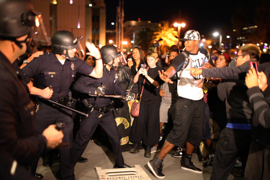 Protesters and police clash in front of LAPD Headquarters as people react to the grand jury decision not to indict a white police officer who had shot dead an unarmed black teenager in Ferguson, Missouri. The shooting ignited nationwide calls to talk about police procedures and the use of deadly force. (Photo by David McNew/Getty Images)